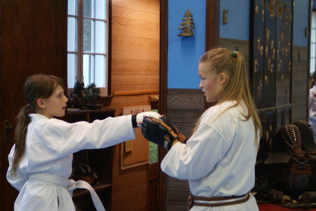 Kids Martial Arts in Port Perry at HBK Martial Arts, Ali teaching Brittany