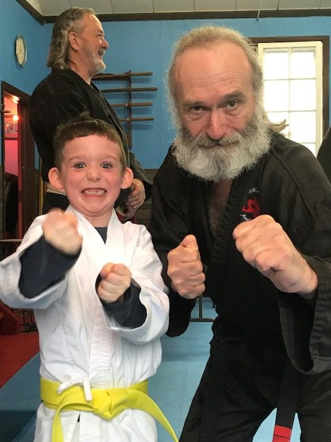 Port Perry Kids Martial Arts, Lochlan & Sensei Jim Shullman. Lochlan looking happy to get his yellow belt at HBK Martial Arts.